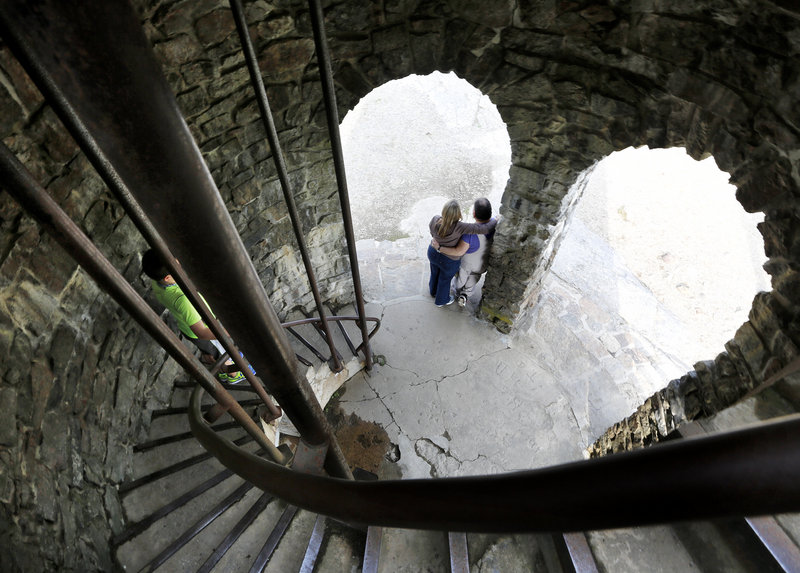 A couple has a picture taken at a World War I memorial at the top of Mount Battie near Camden on Maine's picturesque midcoast.