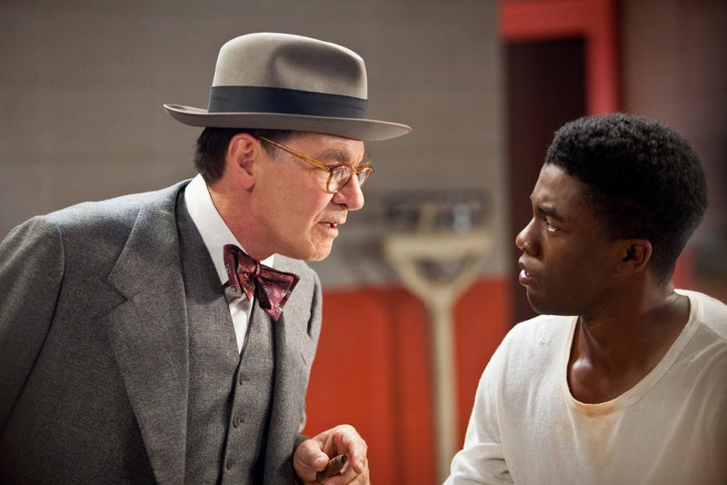 "Harrison Ford as Branch Rickey and Chadwick Boseman as Jackie Robinson in ""42."""