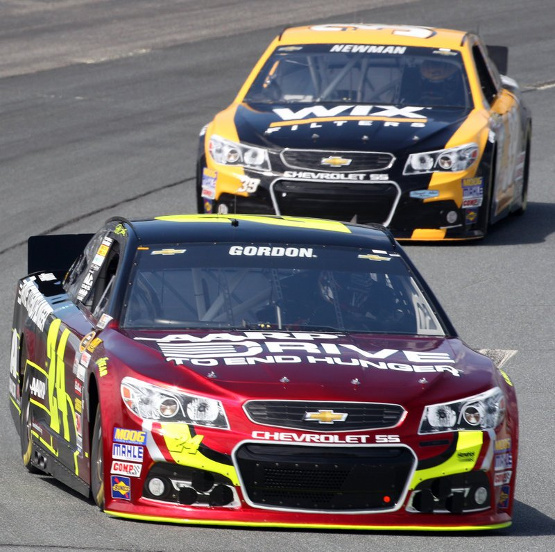 Jeff Gordon leads Ryan Newman as they round the second turn Friday during practice for the Sprint Cup race Sunday at Loudon, N.H. Gordon, who is 14th in the point standings with the top 12 making the Chase, will start the race in the fifth position.