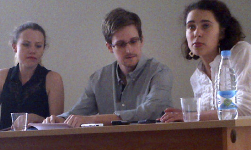 "Edward Snowden, center, holds a news conference at Moscow's Sheremetyevo Airport Friday with Sarah Harrison, left, of WikiLeaks. Snowden defended his disclosure of secret surveillance undertaken by the United States and said he has no regrets because ""it was the right thing to do."" The woman at right was not identified."