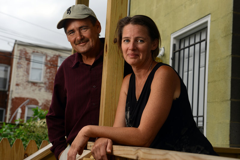 Siblings John and Contessa Riggs, photographed Friday at her Washington home, were fishing with her son, their niece and their father Tuesday when their skiff overturned.