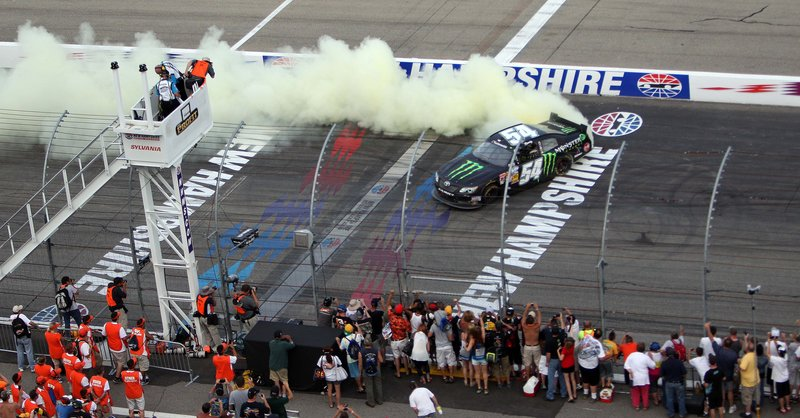 Kyle Busch does a burnout Saturday at New Hampshire Motor Speedway after earning his seventh Nationwide Series win of the season.