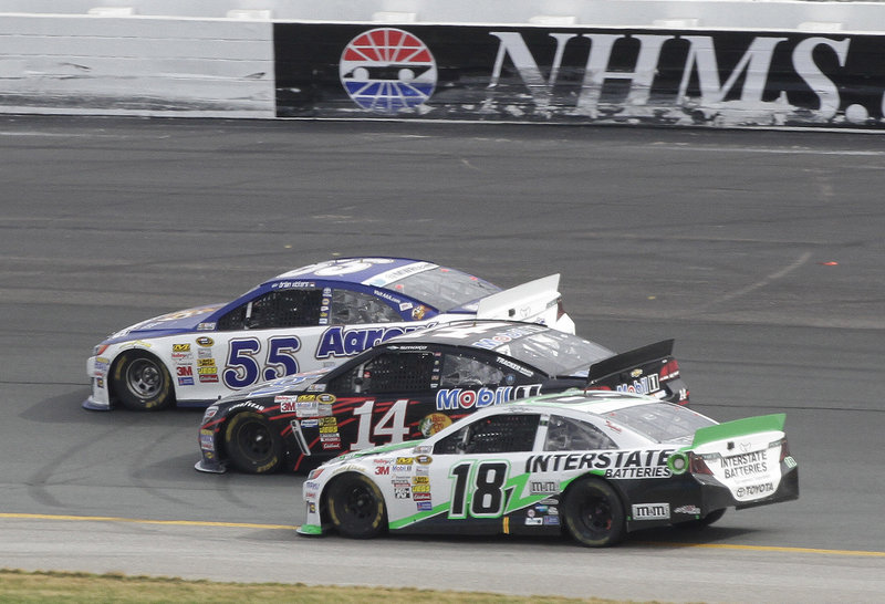 Brian Vickers (55) leads by a nose over Tony Stewart (14) with Kyle Busch (18) just behind at New Hampshire Motor Speedway in Loudon, N.H., Sunday afternoon.
