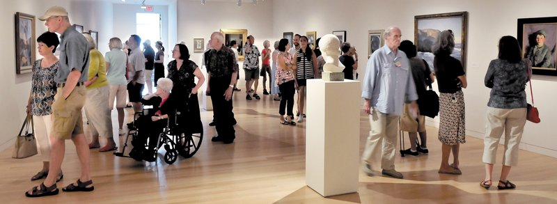 There were more patrons than art pieces in one of the sections of the expanded Colby College Museum of Art in Waterville on Sunday, when a special community celebration of the museum was held.