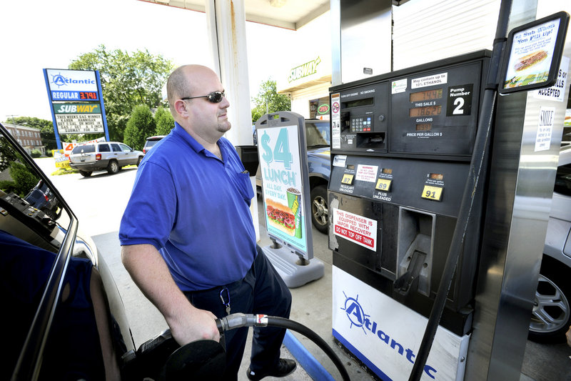 Tom Vire of Westbrook fuels up Monday at the Atlantic station on Broadway in South Portland. Maine's average price for regular gas was $3.71 Monday, 7 cents above the national average. A month ago the Maine price was $3.58, 6 cents below the national average.