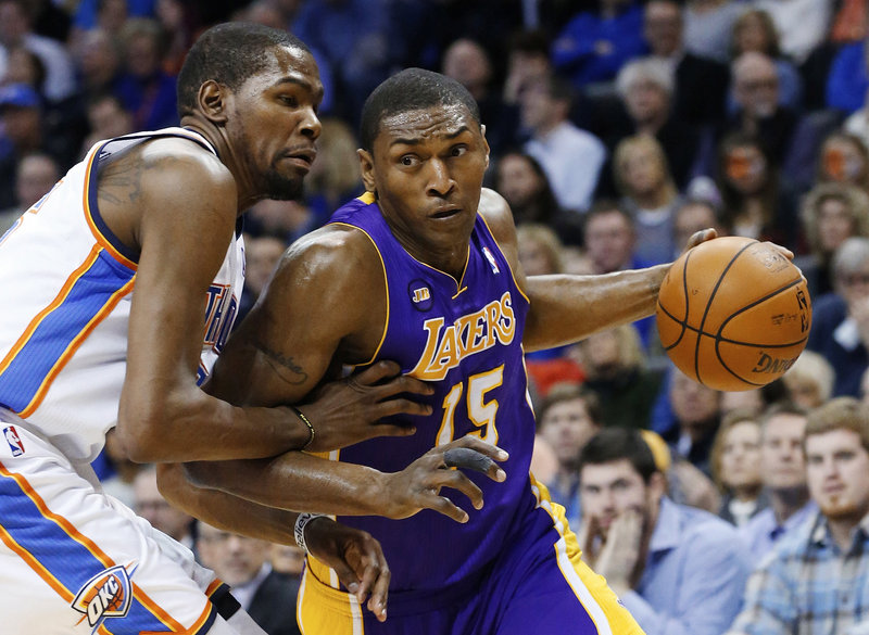 Metta World Peace, shown driving around Oklahoma City's Kevin Durant last season while playing for the Lakers, expects to sign with the New York Knicks.