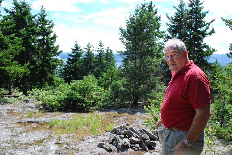 Forester Hank McPherson, owner of Burnt Mountain, welcomes the public to explore and enjoy nature on the 1,800 acres he's developing beside Moosehead Lake.