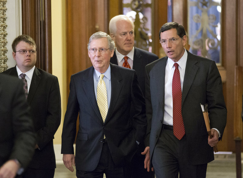 Sens. John Barrasso, R-Wyo., right, John Cornyn, R-Texas, and Mitch McConnell, R-Ky., walk to a meeting Monday.