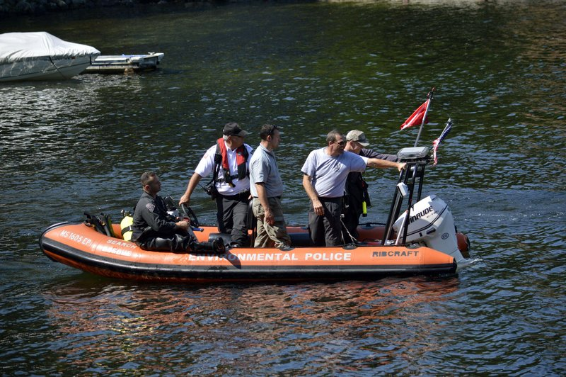 Massachusetts and New York State Police dive teams head out on Greenwater Pond to search for the body of James