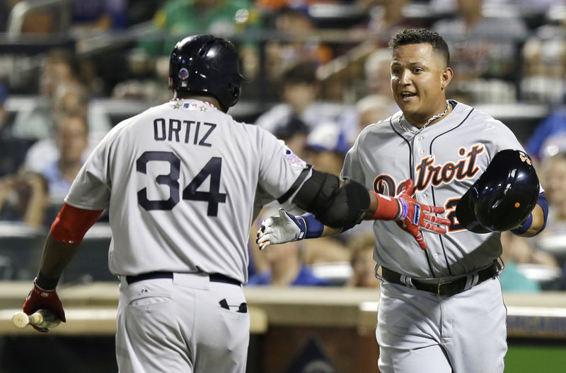 David Ortiz of the Boston Red Sox congratulates Miguel Cabrera of the Detroit Tigers after Cabrera scored on Jose Bautista's sacrifice fly in the fourth inning of the American League's 3-0 victory Tuesday.
