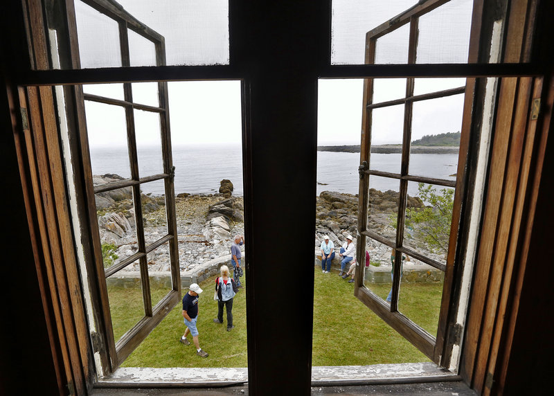 Visitors take a tour of the buildings at Timber Point in the Rachel Carson Wildlife Refuge in Biddeford in 2013.