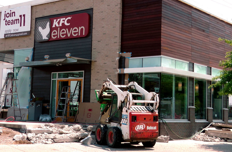"A KFC in Louisville, Ky., undergoes remodeling on its way to becoming a ""KFC eleven."" The location, near company headquarters, will also serve flatbreads and salads."