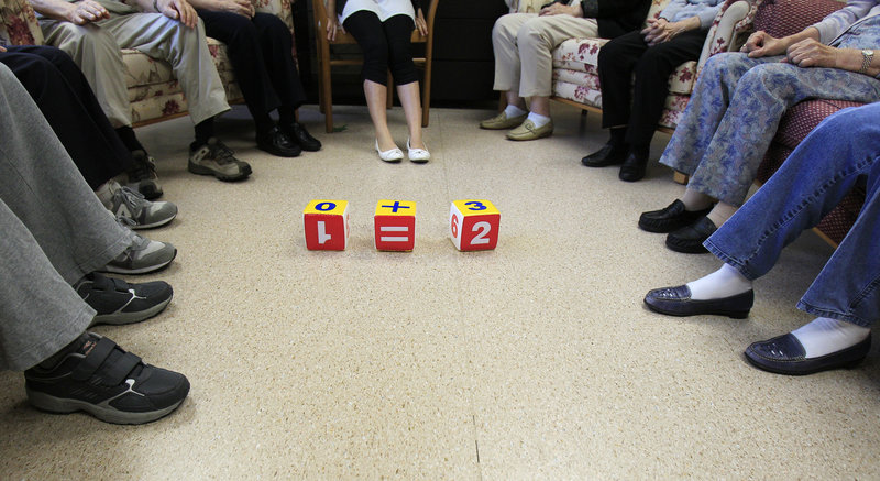 People attend memory training at a community center in Hong Kong. Noticing you have had a decline beyond the occasional misplaced car keys or forgotten name could be the very earliest sign of Alzheimer's, several research teams are reporting.