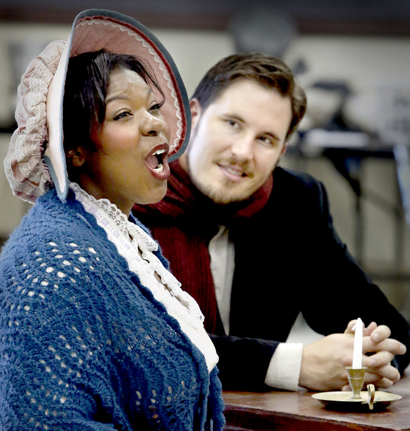 "Michelle Johnson as Mimi and Jeffrey Gwaltney as Rodolfo rehearse a scene from ""La Boheme."" The PORTopera production opens Wednesday at Merrill Auditorium."
