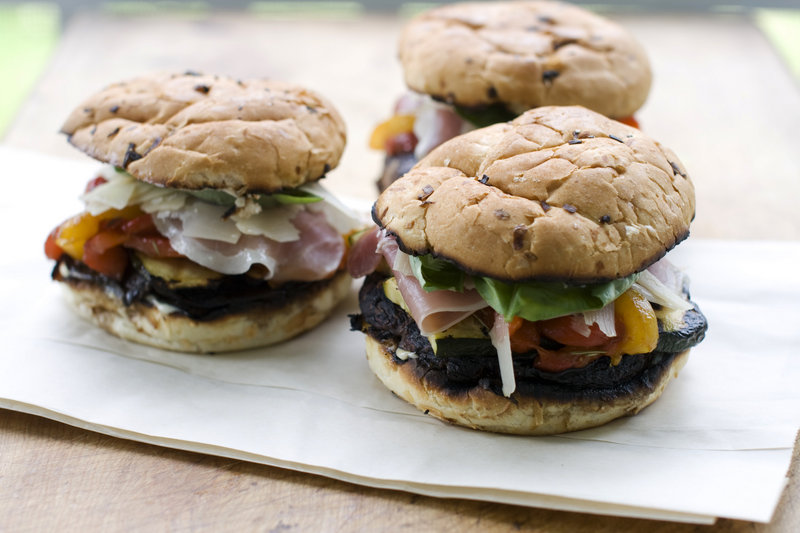 Grilled veggie sandwiches with roasted garlic mayonnaise are just the thing to make after a trip to the farmers market. Since the vegetables are good hot or cold, they can be grilled ahead and refrigerated and the sandwiches assembled just before serving. The roasted garlic makes almost any recipe better, adding a mellow, smoky flavor.