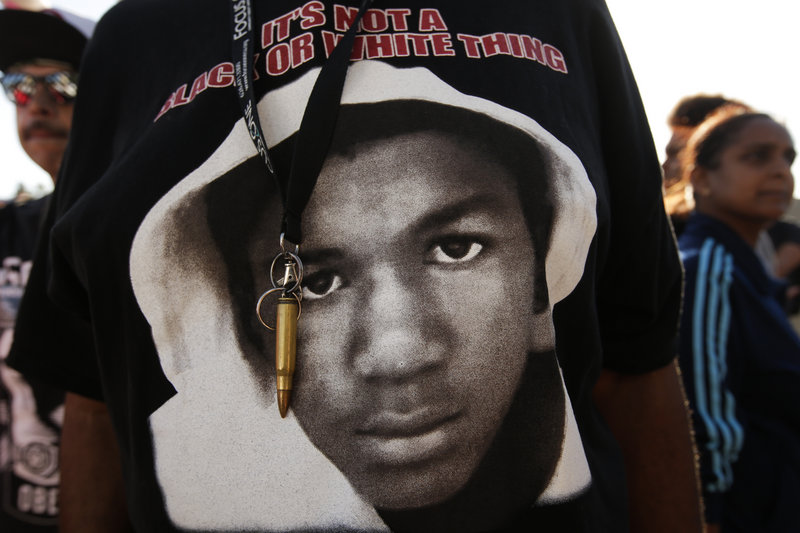 An image of Trayvon Martin and a bullet shell keychain are seen at a protest in Los Angeles on July 15 in response to George Zimmerman's acquittal in the fatal shooting of the teenager in 2012.