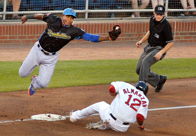 Maikel Franco of the Reading Fightin Phils leaps to snag a throw as Portland's Michael Almanzar slides safely into third during the Sea Dogs' 4-3 loss Friday at Hadlock Field.