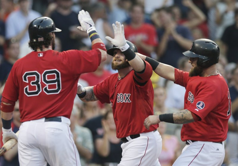 Jonny Gomes, right, is congratulated by Jarrod Saltalamacchia after hitting a two-run homer Friday night for the Boston Red Sox in the second inning of a 4-2 victory against the New York Yankees at Fenway.