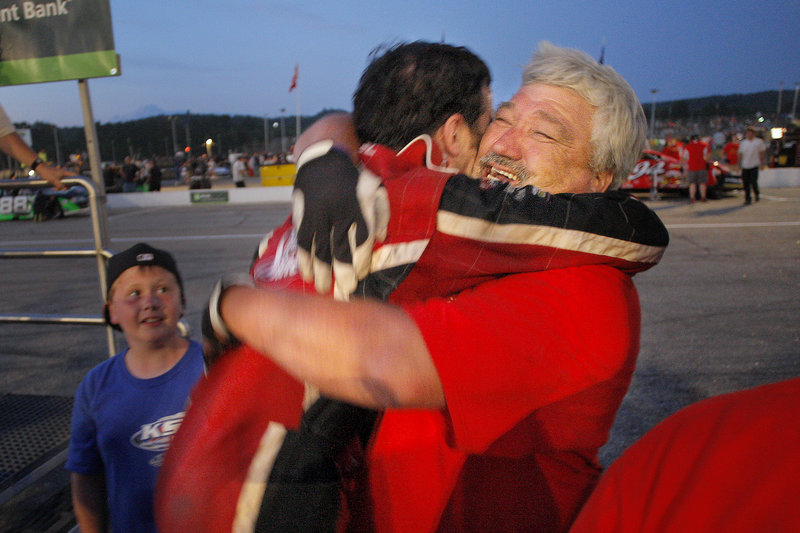 Travis Benjamin, left, gets a bear hug from pit crew member Howard Whitney on Sunday. Benjamin credited adjustments to his car for helping him to win the TD Bank 250.