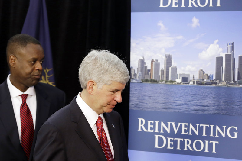 Michigan Gov. Rick Snyder, right, and state-appointed emergency manager Kevyn Orr leave a news conference in Detroit after addressing the city's bankruptcy Thursday.