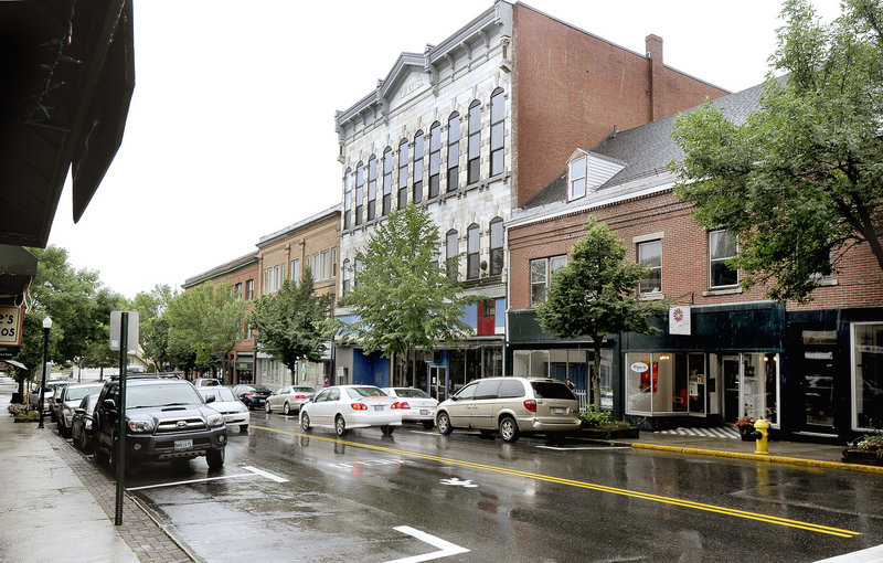 Ackerman is renovating the former Renys store, center, to turn it into an arts and design center.