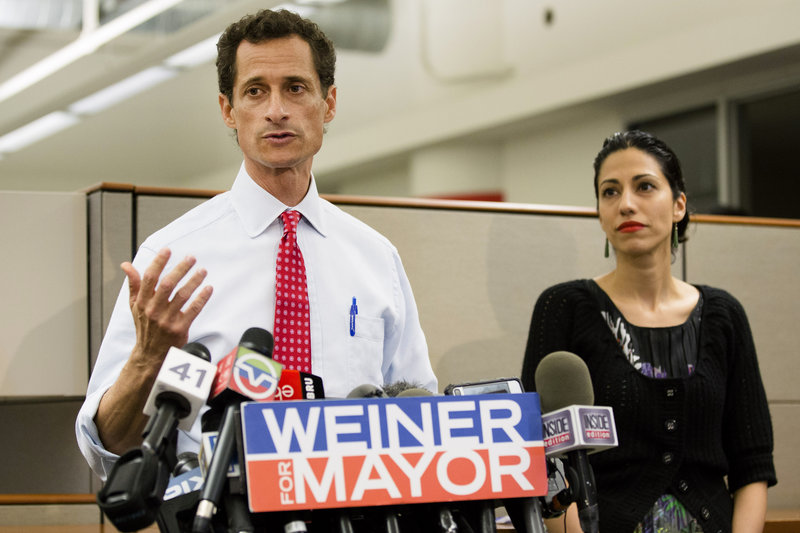 Huma Abedin looks on Tuesday as her husband, Anthony Weiner, says he's not dropping out of the New York mayoral race in light of newly revealed sexting with a young woman.