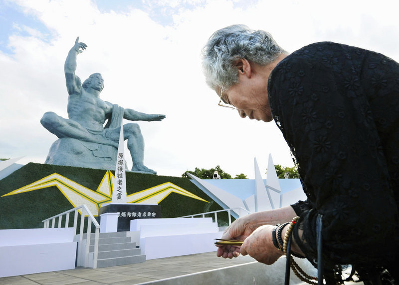 A woman prays Aug. 9, 2008, in front of the Statue of Peace, hours ahead of a ceremony to mark the 1945 atomic bombing of Nagasaki, Japan. Maine voters must contact congressional delegation members about heeding President Obama's recent call for further nuclear stockpile cuts, a reader says.