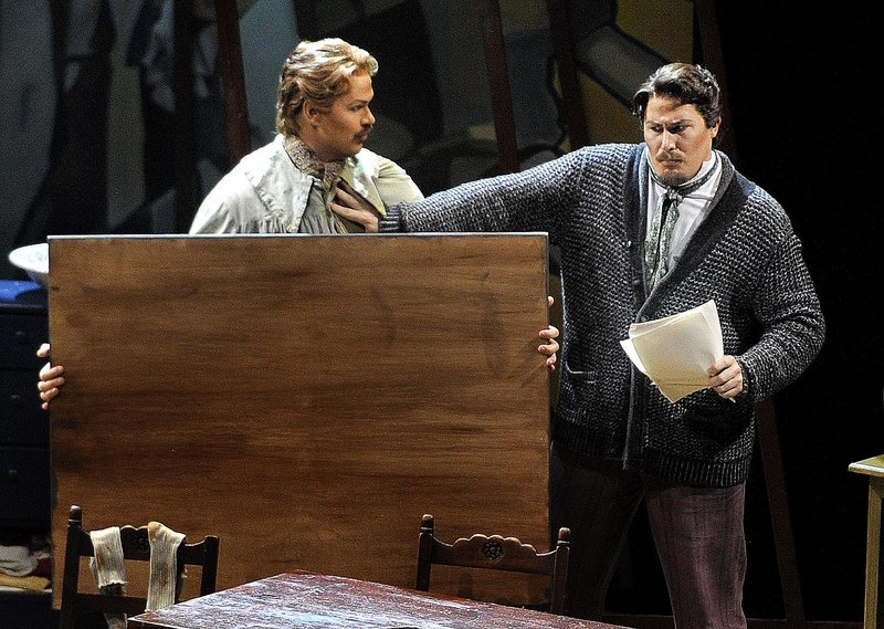 "Edward Parks, in the role of Marcello, is held off by Jeff Gwaltney, as Rodolfo, in the opening performance of Puccini's ""La Boheme"" at Merrill Auditorium in Portland on Wednesday. Director Dona D. Vaughn gives the opera a contemporary feel."