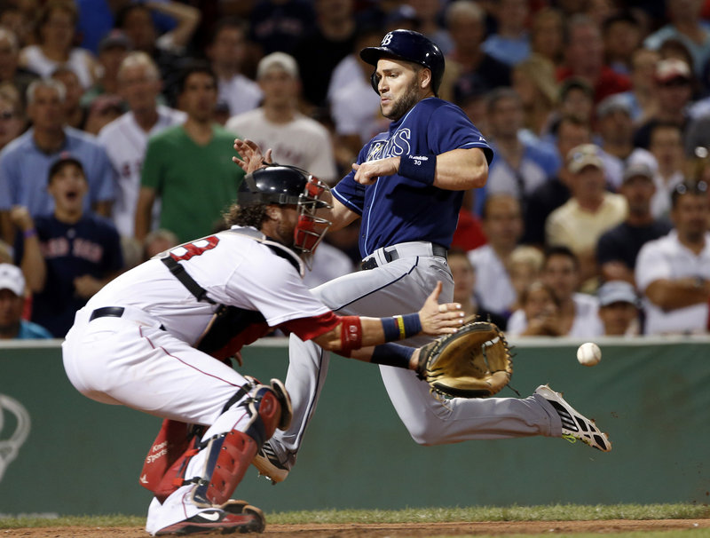 Luke Scott of the Tampa Bay Rays scores on a single by James Loney in the eighth inning Wednesday night as catcher Jarrod Saltalamacchia of the Boston Red Sox prepares for the late throw. Tampa Bay won 5-1 at Fenway.