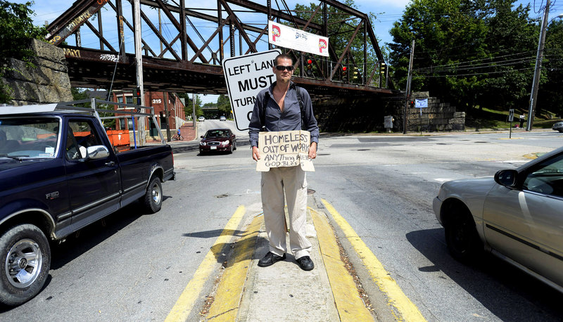 Shane Boilard says a day of panhandling on a Portland traffic median nets him $10 and that, along with food stamps, allows him some semblance of a life, but that would be jeopardized if the city forces him off the streets.