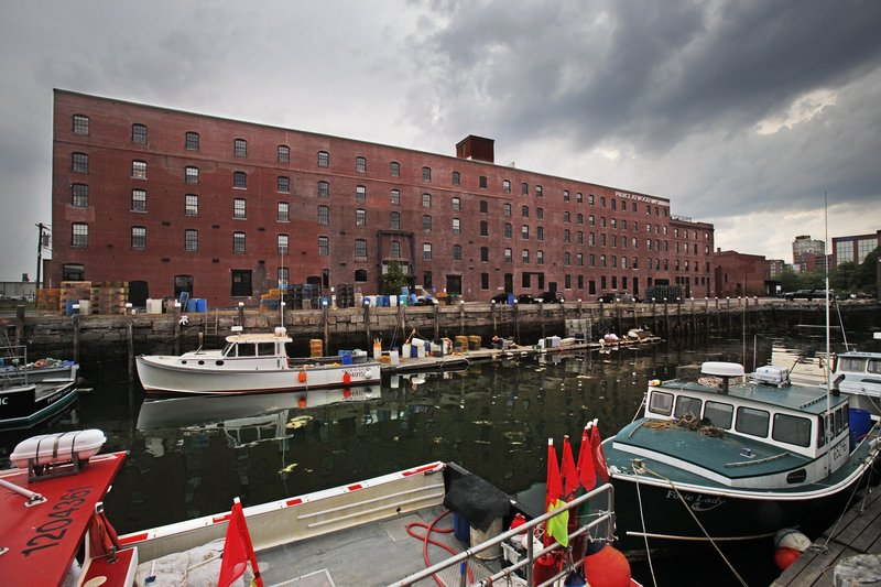 After converting this Merrill's Wharf building into Pierce Atwood offices, Waterfront Marine couldn't find marine-use tenants for the ground floor. But there's also good news for Portland's working waterfront: Shucks Maine Lobster is leasing 19,000 square feet of space at the Maine State Pier for lobster processing.