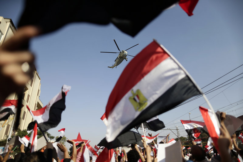 Demonstrators turn out in the hundreds of thousands to show support for the Egyptian army Friday. Crowds supporting ousted President Mohammed Morsi also rallied, but their presence was stifled by the military.