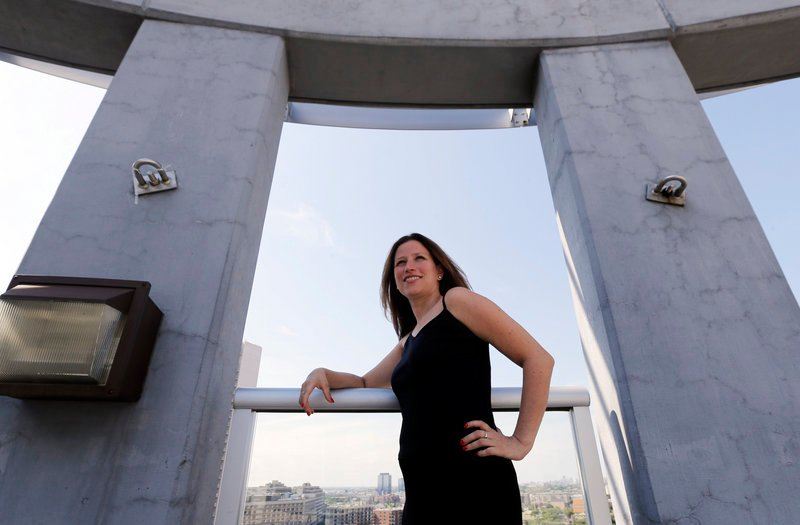 Maura Duffy, 35, poses on the deck atop her apartment building in Chicago. Adopted at birth, Duffy is among 8,800 Illinois residents who have been able to see their birth certificates after the records were unsealed in 2010.