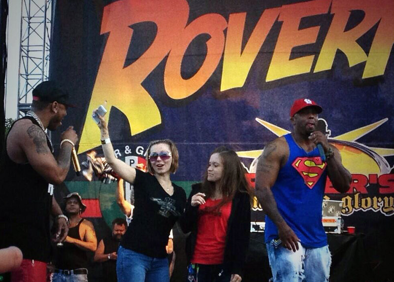 Amanda Berry, wearing sunglasses, makes a surprise appearance at the RoverFest concert in Cleveland on Saturday, one day after her captor, Ariel Castro, pleaded guilty.