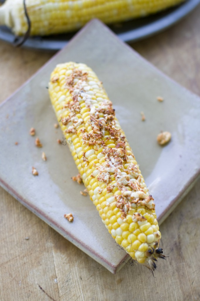 Shaved queso fresco makes grilled corn on the cob especially delicious.