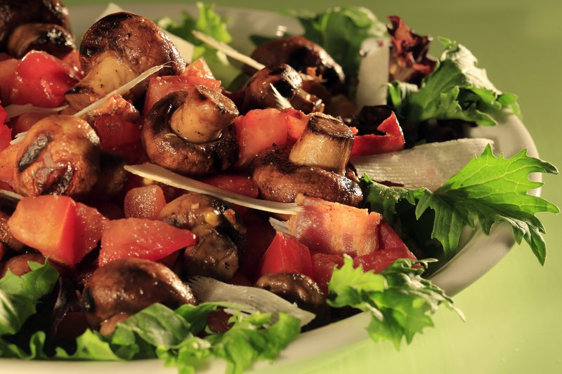 Above: Foods naturally laden with glutamate give this Tomato-Crimini Mushroom and Bacon Salad a flavor punch.