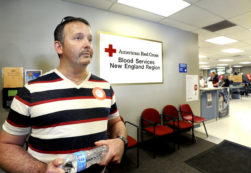 Brian Hodges of West Gardiner waits in line to give blood July 12 at the American Red Cross donor center in Portland. Hodges was turned down under a federal policy that bars gay men from contributing to the blood supply.