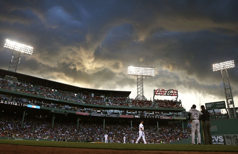 Clouds hang over Fenway Park during a game between the Red Sox and Rays on Monday.