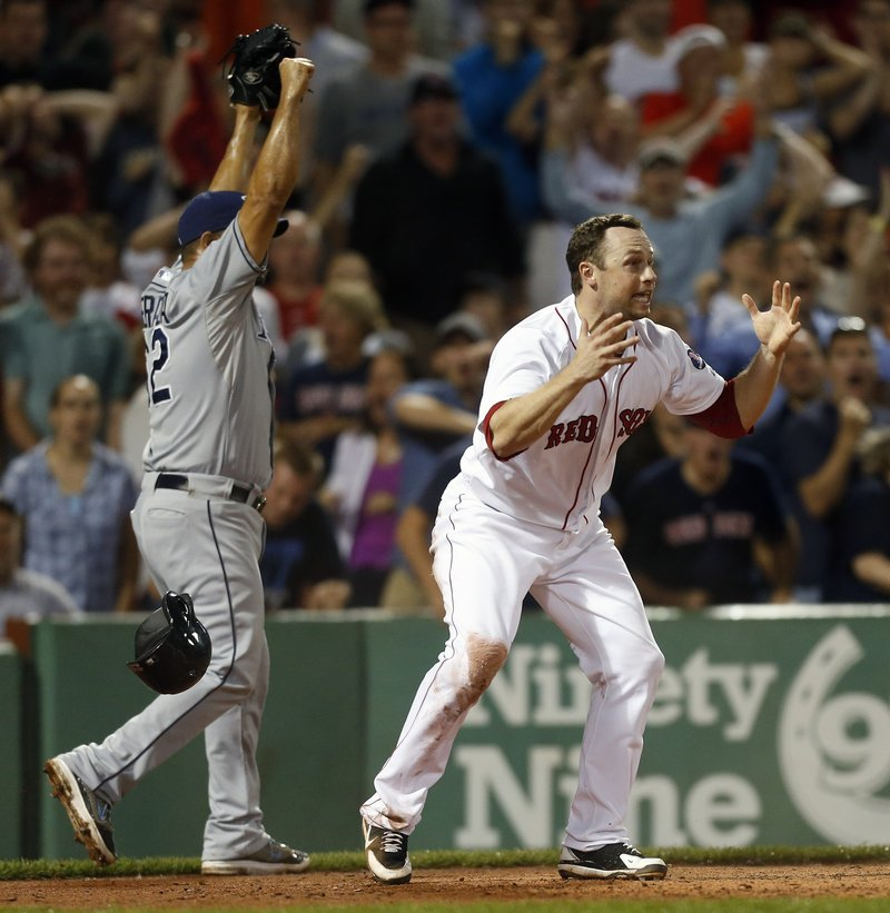 Daniel Nava can't believe he was called out at home by umpire Jerry Meals in the eighth inning Monday night while trying to score from third on a sacrifice fly. The Sox lost to the Rays, 2-1.