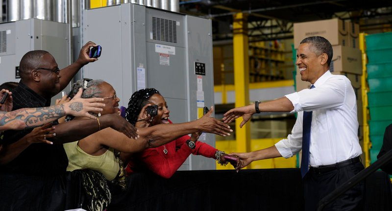 President Obama shakes hands as he arrives to speak at the Amazon fulfillment center in Chattanooga, Tenn., Tuesday as he offered up a new jobs package.