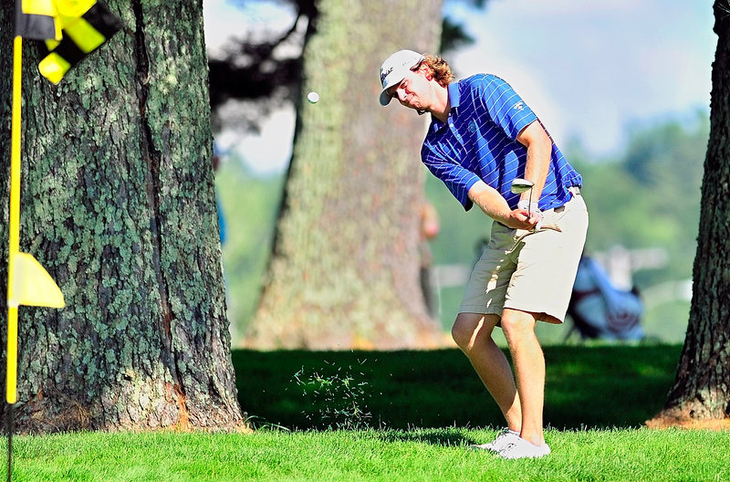 Evan Harmeling chips onto a green on the back nine Tuesday in winning the Maine Open by a stroke.