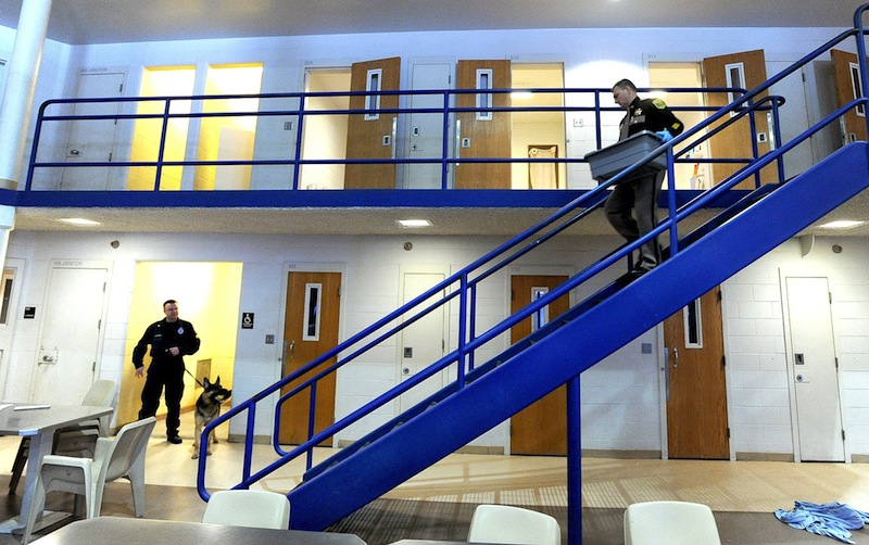In this March 2011 file photo, Cumberland County Jail employees conduct a search for contraband. The Maine State Board of Corrections voted Tuesday to fully fund the state's jails for the rest of the fiscal year, even though the board doesn't have enough to pay for even 25 percent of the requests, in hopes of forcing the Legislature to cough up the rest of the promised funding.