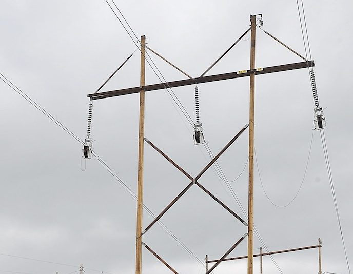 In this May 2013 file photo, power lines at the corner of County Road and Smutty Lane in Saco. A federal judge has ruled that New England electric transmission companies should make less money on power line projects, a decision Massachusetts' attorney general said could lower electric bills.