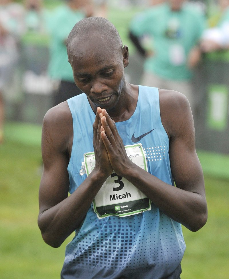 Race winner Micah Kogo, from Kenya, takes a moment to reflect after winning Saturday's Beach to Beacon at Cape Elizabeth on Saturday.