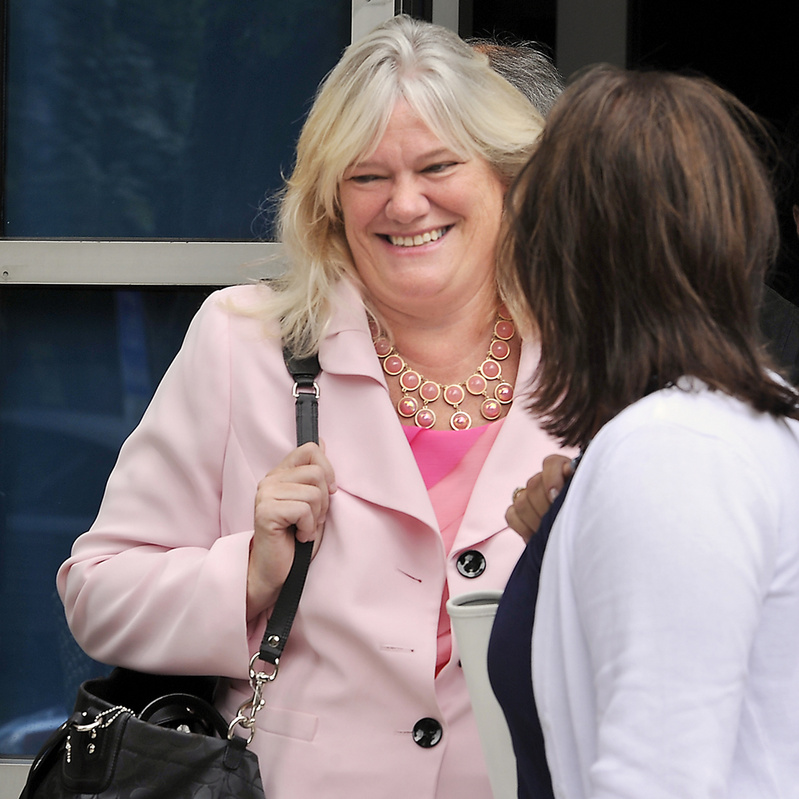 Suzanne Joyce leaves the Cumberland County Courthouse in Portland on Thursday, where her attorney and a prosecutor met with a judge.