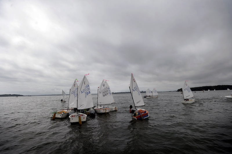 Competitors wait in Casco Bay for the start of the 2013 U.S. Optimist Dinghy Association's New England Championship Regatta on Thursday, August 8, 2013.