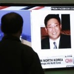 """A South Korean man watches a television news program showing Korean American Kenneth Bae at the Seoul Railway Station in South Korea in this May 2, 2013, photo. Bae has been sentenced by North Korea to 15 years of hard labor for """"hostile acts"""" against the state."""