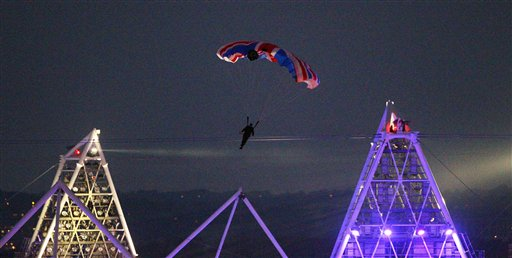 In this July 27, 2012, photo, stuntman Mark Sutton, dressed as James Bond, parachutes into the Olympic Stadium during the opening ceremony.
