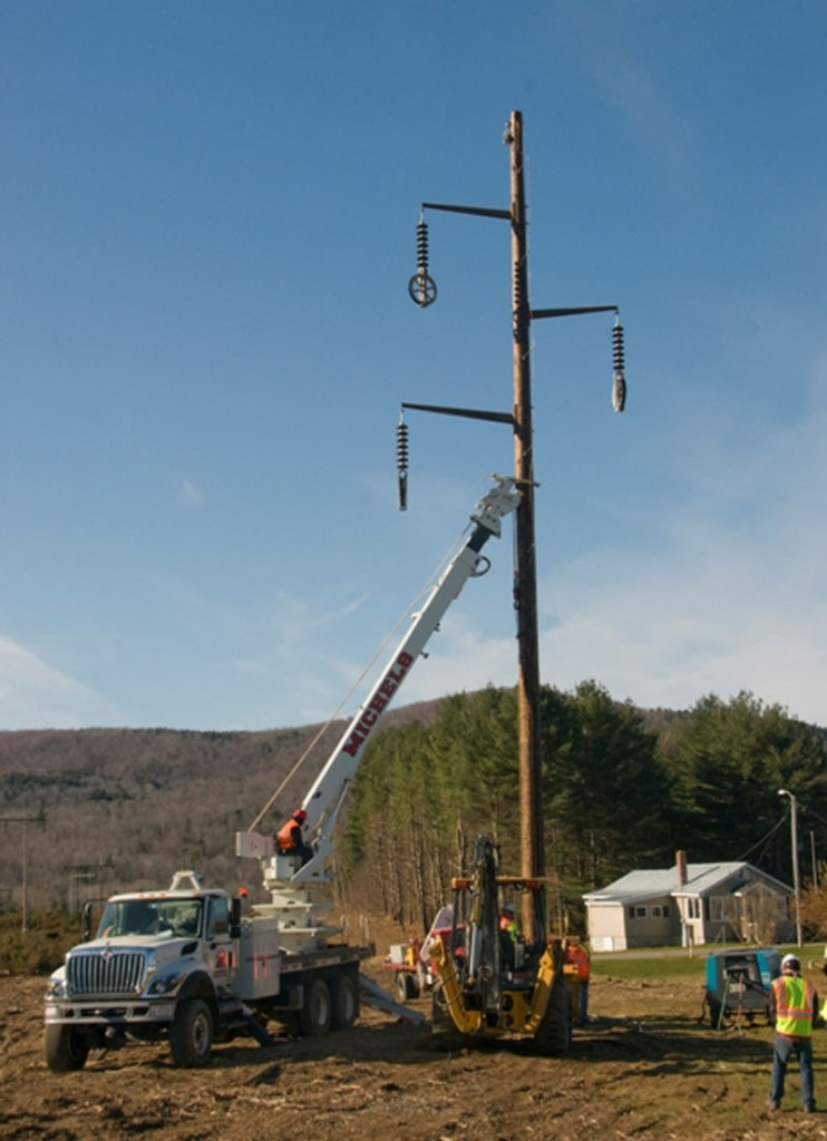 Central Maine Power Co. contractors erect a new 39-mile transmission line from Moscow to Benton in this November 26, 2011 file photo.