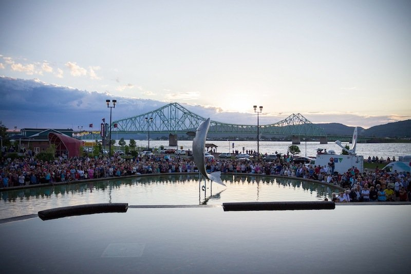 Mourners gather for a vigil to remember Noah and Connor Barthe on Wednesday, Aug. 7, 2013 in Campbellton, New Brunswick. The vigil opened with a moment of silence to pay respects to the boys, whose deaths have triggered a global outpouring of sympathy. (AP Photo/The Canadian Press, John LeBlanc)